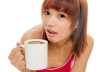 Chinese female in red dress with coffee cup photo
