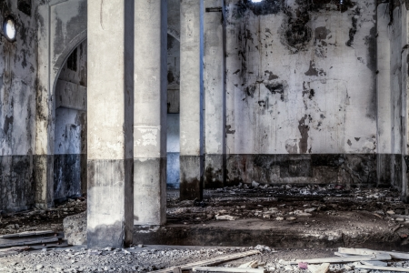 Urban decay, old gold smelting factory interior with pillars photo