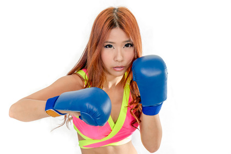 Chinese female in pink top wearing boxing gloves photo