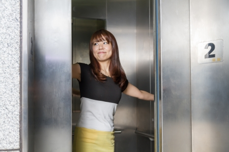 Attractive Japanese female at an elevator