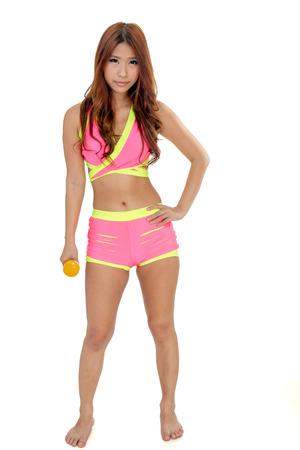 Beautiful Chinese female working out with weights photo