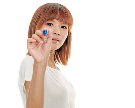 Taiwanese woman writing on futuristic board with blue marker photo