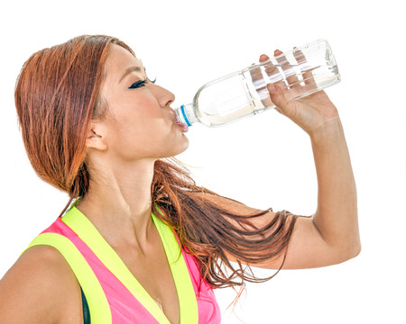 Beautiful Chinese woman with water bottle after exercise photo