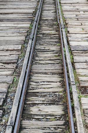 narrow gauge: Deserted narrow gauge train track with wooden beams