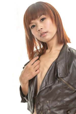 Topless Chinese female with leather jacket Stock Photo - 26506929