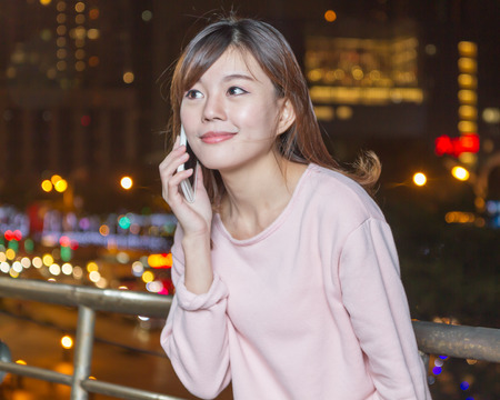 Attractive Malaysian Woman Talking on Phone photo