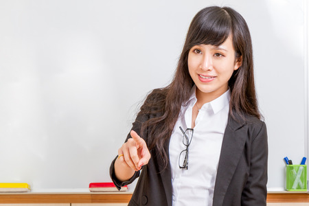 Chinese teacher in front of whiteboard dressed formal photo