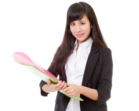Chinese woman carrying green and pink folders