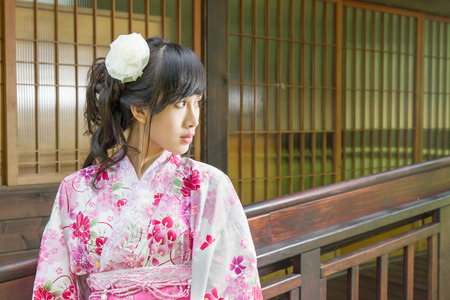 Chinese lady wearing kimono by Japanese house photo