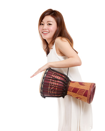 Malay woman playing an african hand drum Stock Photo