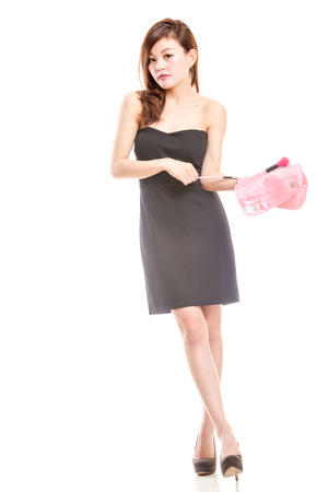 Malay woman in black dress with cosmetics bag photo