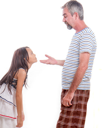 Father scolding naughty daughter. Pointing finger.