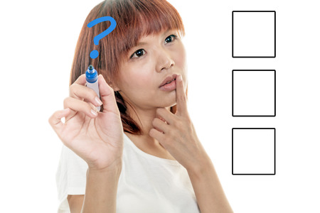 Taiwanese woman writing on futuristic board with blue marker, business and technology concept photo
