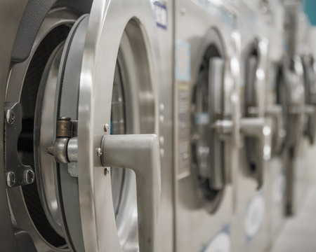 Row of washing machines at a public laundrette photo