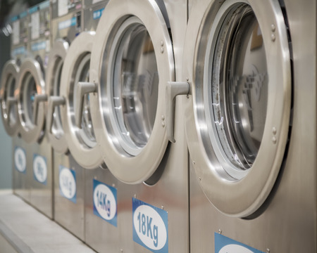 machines: Row of washing machines at a public laundrette
