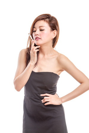 Asian woman in black dress with a cigarette smoking photo