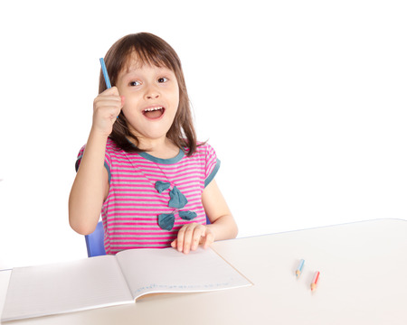 Asian caucasian girl doing homework at desk, back-to-school