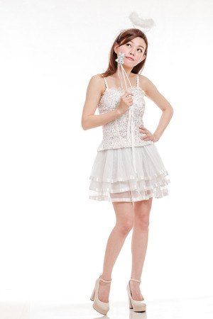 Chinese woman in white angel fairy costume thinking photo