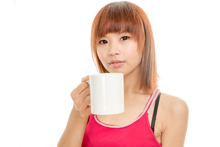 Chinese female in red dress with coffee mug