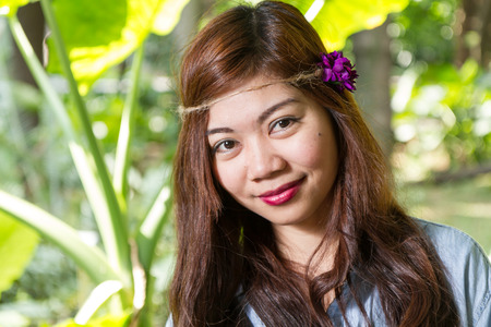 pinoy: Pinoy woman in a green garden on farm