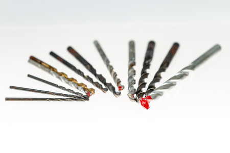 Assorted drill bits on isolated white background