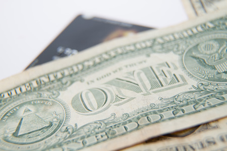 One dollar bills on top of bank card,  shallow depth of field Stock Photo