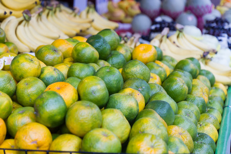 taiwanese: Limes at fruit stall in a traditional Taiwanese market Stock Photo