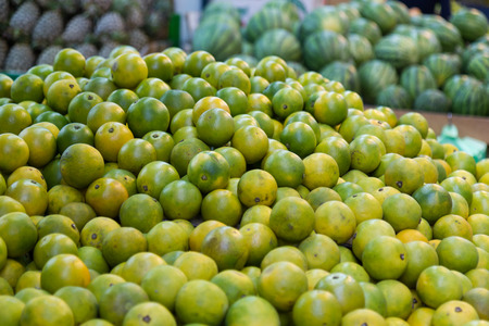 Limes at fruit stall in a traditional Taiwanese market