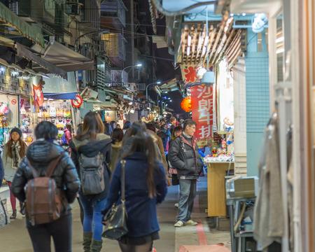 night market: TAIPEI CITY, TAIPEI, TAIWAN. DECEMBER 17, 2014.  People walking through Shida night market in Taipei City Editorial