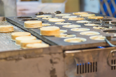 night market: Chelun bing sweet pies being prepared at a night market vendor