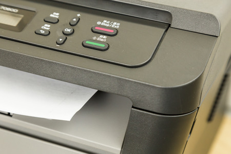 Close-up of printer printing documents on paper
