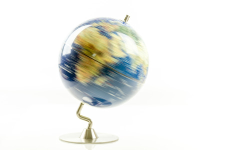 Globe of the world spinning isolated on white background Foto de archivo