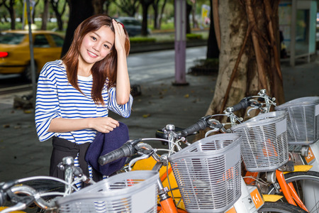 rentals: Woman standing by bicycle rentals