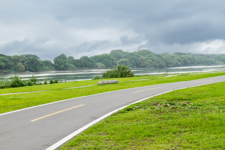 Cycling and jogging path by riverside recreational area photo