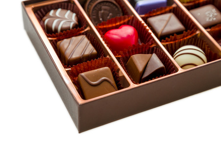 Assorted chocolates in brown box, with red heart chocolate Standard-Bild