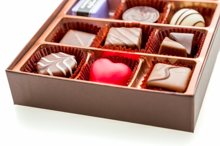 brown box: Assorted chocolates in brown box, with red heart chocolate Stock Photo