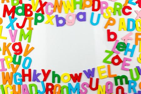 Frame of Colorful alphabet magnets on a whiteboard photo