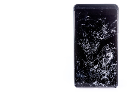 Closeup of mobile smartphone with broken screen isolated on white, with copyspace Standard-Bild