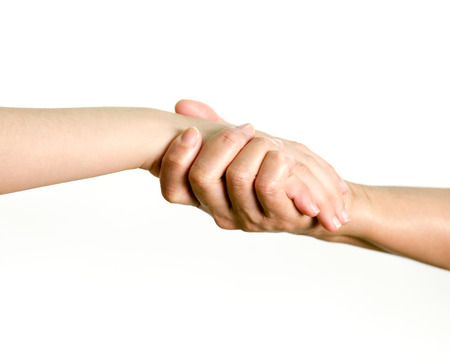 Young girl and older woman holding hands, mother and daughter. Concept of love, help, and trust Stock Photo