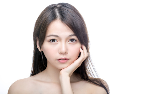 Beautiful Asian woman touching perfect face skin . Healthy skincare concept looking at camera.