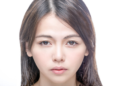 Beautiful Asian woman with perfect skin . Healthy skincare concept looking at camera.