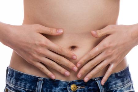 onto: Woman applying cream onto stomach