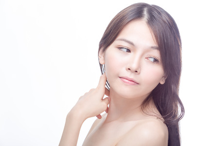Asian beauty portrait of Chinese model with hand on face