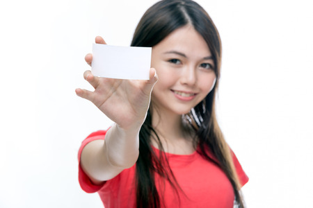 Out of focus Chinese woman holding up business card, left blank for copy space Foto de archivo