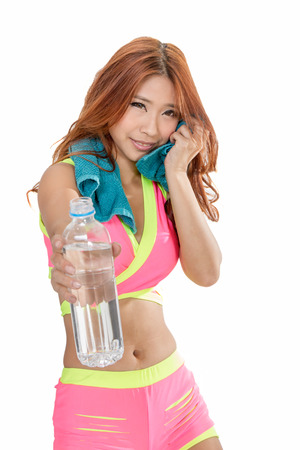 out of water: Chinese woman holding out water bottle after workout