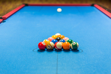 billiards halls: Balls racked on a pool table waiting for break