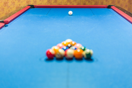 pool halls: Balls racked on a pool table waiting for break