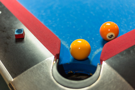 snooker hall: Ball near corner pocket of a pool table Stock Photo