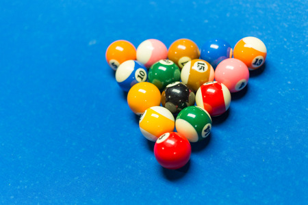 snooker halls: Balls racked on on a pool table with blue felt