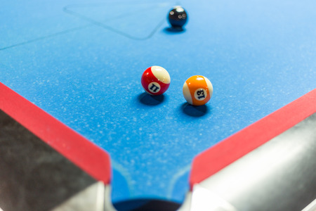 snooker hall: Balls on a pool table with blue felt Stock Photo